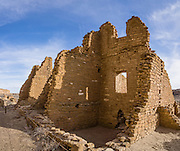 Kin Kletso Great House was built around 1120-1130 AD (based on tree-ring dates) with 65 rooms and five kivas, but was abandoned by the 1150s AD. Chaco Culture National Historical Park hosts the densest and most exceptional concentration of pueblos in the American Southwest and is a UNESCO World Heritage Site. Chaco Canyon is in remote northwestern New Mexico, between Albuquerque and Farmington, USA. From 850 AD to 1250 AD, Chaco Canyon advanced then declined as a major center of culture for the Ancient Pueblo Peoples. Chacoans quarried sandstone blocks and hauled timber from great distances, assembling fifteen major complexes that remained the largest buildings in North America until the 1800s. Climate change may have led to its abandonment, beginning with a 50-year drought starting in 1130. This panorama was stitched from 3 overlapping photos.