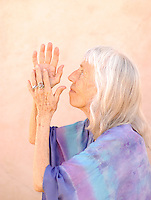 """Photograph of a senior woman in devotional gesture.<br /> :::<br /> """"The most beautiful people we have known are those who have known defeat, known suffering, known struggle, known loss, and have found their way out of those depths.""""<br /> -Elisabeth Kubler-Ross"""