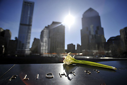 March 9, 2013 - New York, New York, USA - An unidentified woman takes a photo at The World Trade Center Memorial in New York City, New York on Saturday, March 09, 2013. 12 years ago, two planes were flown into the twin towers, formerly located here, as part of a terrorist attack on American soil. (Credit Image: © Josh Edelson/ZUMAPRESS.com)