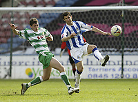 Photo: Aidan Ellis.<br /> Huddersfield Town v Yeovil Town. Coca Cola League 1. 29/04/2006.<br /> Yeovil's Phil Jevons and Huddersfield's Martin McIntosh