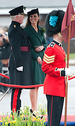 © London News Pictures. 17/03/2012. Aldershot, UK. The Duchess of Cambride CATHERINE (KATE) MIDDLETON on the dias before presenting traditional sprigs of shamrock to the 1st Battalion Irish Guards at Mons Barracks in Aldershot, Hampshire, UK,  on Saint Patrick's Day, March 17th, 2012.  Photo credit : Ben Cawthra/LNP.