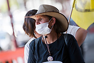 A protester is seen wearing a facemask during an Extinction Rebellion protest in Melbourne.  A small group of climate protesters marched from Flagstaff Gardens to The Queen Victoria Market and ending with two individuals gluing themselves together, and then glued themselves to Victoria Avenue outside of the Market. This comes as 5 new COVID-19 cases were uncovered in Melbourne's revamped Hotel Quarantine, breaking almost 40 days of virus free days. (Photo by Dave Hewison/Speed Media)