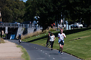 Locals are seen jogging along the Yarra during the 35th day of zero COVID-19 cases in Victoria, Australia. School and community sport is ramping up and as the weather improves, more people are venturing out and about to enjoy this great city. Pressure is mounting on Premier Daniel Andrews to keep his promise of removing all remaining restrictions. (Photo by Dave Hewison/Speed Media)