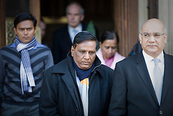 © Licensed to London News Pictures. 04/01/2012. London, UK.  SUBHASH BIDVE (centre) father of murdered Indian student ANUJ BIDVE leaving the Houses of Parliament with his wife YOGINI BIDVE (rear right), Son in law RAKESH SONAWANE (rear left) and Leicester MP Keith Vaz (right) London on January 4th, 2012 after arriving in the UK from Mumbai. The Family of 20 year-old ANUJ BIDVE, are expected to travel to Manchester to visit the scene where ANUJ was shot dead.  Photo credit: Ben Cawthra/LNP