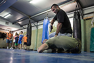 Sarosi family assist to a Krav Maga, letal self defense system developed for Israeli army, demonstration in the center's gym. In the center there are different facilities used for training.