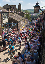 Competitors ride through Haworth during day four of the Tour de Yorkshire from Halifax to Leeds.