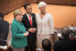 July 8, 2017 - Hamburg, Germany - German Chancellor Angela Merkel, left, stands with Indonesian President Joko Widodo, center, and Director of the International Monetary Fund Christine Lagarde before the start of the third plenary session on the final day of G20 Summit meeting at the Hamburg Trade Congress Center July 8, 2017 in Hamburg, Germany. (Credit Image: © Guido Bergmann/Planet Pix via ZUMA Wire)