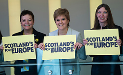 Edinburgh, Scotland, UK. 27 April, 2019. SNP ( Scottish National Party) Spring Conference takes place at the EICC ( Edinburgh International Conference Centre) in Edinburgh. Pictured; First Minister Nicola Sturgeon and other SNP politicians hold placards on balcony of the conference centre.