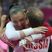 Aliya Mustafina, Russia, is congratulated by her coaches after winning the Gold Medal in the Gymnastics Artistic, Women's Apparatus, Uneven Bars Final at the London 2012 Olympic games. London, UK. 6th August 2012. Photo Tim Clayton