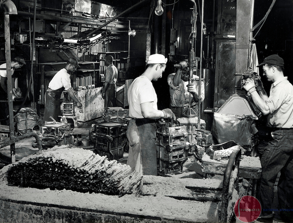 Studebaker Foundry workers operate a chunk core slinger c. 1950.