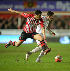 Craig Woodman of Exeter City battles for the ball with Ryan Kent of Liverpool - Mandatory byline: Alex James/JMP - 08/01/2016 - FOOTBALL - St James Park - Exeter, England - Exeter City v Liverpool - FA Cup Third Round