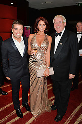 Left to right, JOE McELDERRY, AMY CHILDS and CHRISTOPHER BIGGINS at the Soldiering On Awards held at the Park Plaza Hotel, Westminster Bridge, London on 5th April 2014.