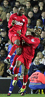 Fotball<br /> Foto: SBI/Digitalsport<br /> NORWAY ONLY<br /> <br /> 26/10/2004 <br /> <br /> Millwall v Liverpool<br /> <br /> Carling Cup 3rd Round, The New Den<br /> <br /> Liverpools Salif Diao celebrates his goal with team mate Florent Sinama Pongolle.