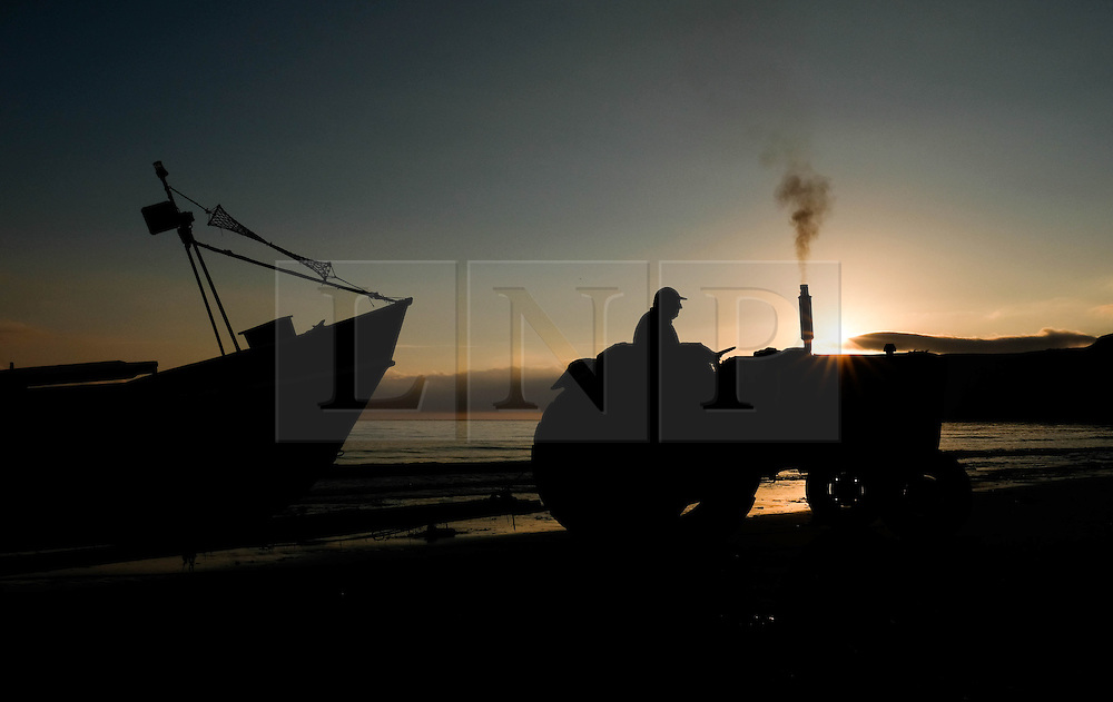 © Licensed to London News Pictures. <br /> 18/08/2016. <br /> Satburn-By-The-Sea, UK.  <br /> <br /> The crew of the fishing boat 'Ellen' launch their boat from the beach before checking lobster and crab pots as the sun rises over Saltburn-By-The-Sea.<br /> <br /> Photo credit: Ian Forsyth/LNP