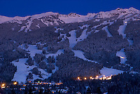 The sliding centre is visible on Blackcomb Mountain on a winter twilight evening in Whistler, BC, Canada.