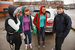 Group of teenagers in car park. Cleared for Mental Health Issues.