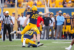 Oct 2, 2021; Morgantown, West Virginia, USA; West Virginia Mountaineers place kicker Casey Legg (48) kicks a field goal during the fourth quarter against the Texas Tech Red Raiders at Mountaineer Field at Milan Puskar Stadium. Mandatory Credit: Ben Queen-USA TODAY Sports