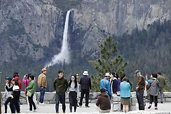April 26, 2017 - Yosemite National Park, CA, USA - Much larger than normal snowfall over the winter of 2016-2017 left Yosemite National Park with an overabundance of water and several road closures in the valley  The southern entrance and road leading to Yosemite Valley will reopen Monday May 1, 2017. Biig Oak Flat Road had been impassable for two months because of a landslide, forcing travelers to take a 22-mile detour.  This is the tunnel view of Bridal Veil Falls, at rear. (Credit Image: © John Gastaldo via ZUMA Wire)