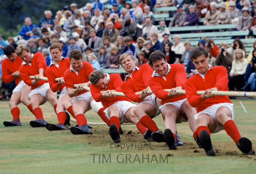 Scottish men taking part in traditional tug of war, tug o' war, at the Braemar Royal Highland Gathering, the Braemar Games in Scotland