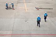 maintenance crew waiting for airplane to arrive at Narita International airport Tokyo Japan