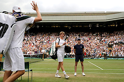 South African eighth seed Kevin Anderson celebrates having reached his first Wimbledon final, beating American ninth seed John Isner 7-6 (8/6) 6-7 (5/7) 6-7 (9/11) 6-4 26-24 in the longest semi-final in the tournament's history on day eleven of the Wimbledon Championships at the All England Lawn Tennis and Croquet Club, Wimbledon. PRESS ASSOCIATION Photo. Picture date: Friday July 13, 2018. See PA story TENNIS Wimbledon. Photo credit should read: Ben Curtis/PA Wire. RESTRICTIONS: Editorial use only. No commercial use without prior written consent of the AELTC. Still image use only - no moving images to emulate broadcast. No superimposing or removal of sponsor/ad logos. Call +44 (0)1158 447447 for further information.