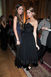 Left to right, AMBER LE BON and PEACHES GELDOF at a party to celebrate 300 years of Tatler magazine held at Lancaster House, London on 14th October 2009.