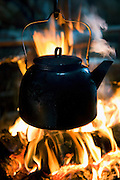 A kettle boils on top of a fire in a lavvu, a temporary home and tent of the Sami people, in Kirkeness, northern Norway