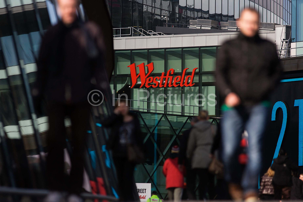 Londoners flock to the Westfield Stratford shopping mall. Situated on the fringe of the 2012 Olympic park, Westfield hosted its first day to thousands of shoppers eager to see Europe's largest urban shopping centre. The £1.45bn complex houses more than 300 shops, 70 restaurants, a 14-screen cinema, three hotels, a bowling alley and the UK's largest casino. It will provide the main access to the Olympic park for the 2012 Games and a central 'street' will give 75% of Olympic visitors access to the main stadium so retail space and so far 95% of the centre has been let. It is claimed that up to 8,500 permanent jobs will be created by the retail sector.