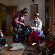 Mala Srikanth (middle standing), inspects the work of a knitter at their weekly Wednesday meeting in Ranikhet, India, on Dec. 4, 2018.