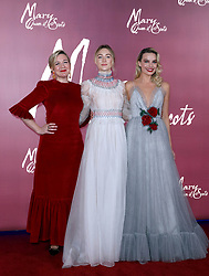(left to right) Director Josie Rourke, Saoirse Ronan and Margot Robbie arrive at the European premiere of Mary Queen of Scots at Cineworld Leicester Square, London.