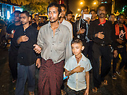23 OCTOBER 2015 - YANGON, MYANMAR: An Ashura procession at Mogul Mosque in Yangon. Ashura commemorates the death of Hussein ibn Ali, the grandson of the Prophet Muhammed, in the 7th century. Hussein ibn Ali is considered by Shia Muslims to be the third imam and the rightful successor of Muhammed. He was killed at the Battle of Karbala in 610 CE on the 10th day of Muharram, the first month of the Islamic calendar. According to Myanmar government statistics, only about 4% of the population is Muslim. Many Muslims have fled Myanmar in recent years because of violence directed against Burmese Muslims by Buddhist nationalists.   PHOTO BY JACK KURTZ