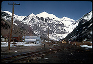 """View, looking east, of Telluride with RGS depot in background.<br /> RGS  Telluride, CO  Taken by August, Irving - 4/15/1949<br /> In book """"RGS Story, The Vol II: Telluride, Pandora and the Mines Above"""" page 74<br /> Thanks to Don Bergman for additional information.<br /> Collman's book credits Dick Kindig with this photo, erroneously I think."""