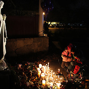 Children and families pay their respects to a shrine around the statue of Mother Mary at the Rose Lima church in Newtown Sandy Hook after yesterday's shootings at Sandy Hook Elementary School, Newtown, Connecticut, USA. 15th December 2012. Photo Tim Clayton