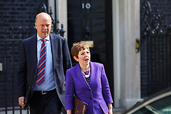 © Licensed to London News Pictures. 10/06/2015. London, UK. Leader of the House of Commons CHRIS GRAYLING and Baroness STOWELL leaving Number 10, Downing Street to attend the Prime Minister's Questions at Parliament on Wednesday, 10 June 2015. Photo credit: Tolga Akmen/LNP