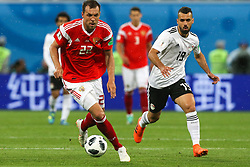 June 19, 2018 - Saint Petersburg, Russia - Artem Dzyuba (L) of the Russia national football team and Abdalla Said of the Egypt national football team vie for the ball during the 2018 FIFA World Cup match, first stage - Group A between Russia and Egypt at Saint Petersburg Stadium on June 19, 2018 in St. Petersburg, Russia. (Credit Image: © Igor Russak/NurPhoto via ZUMA Press)