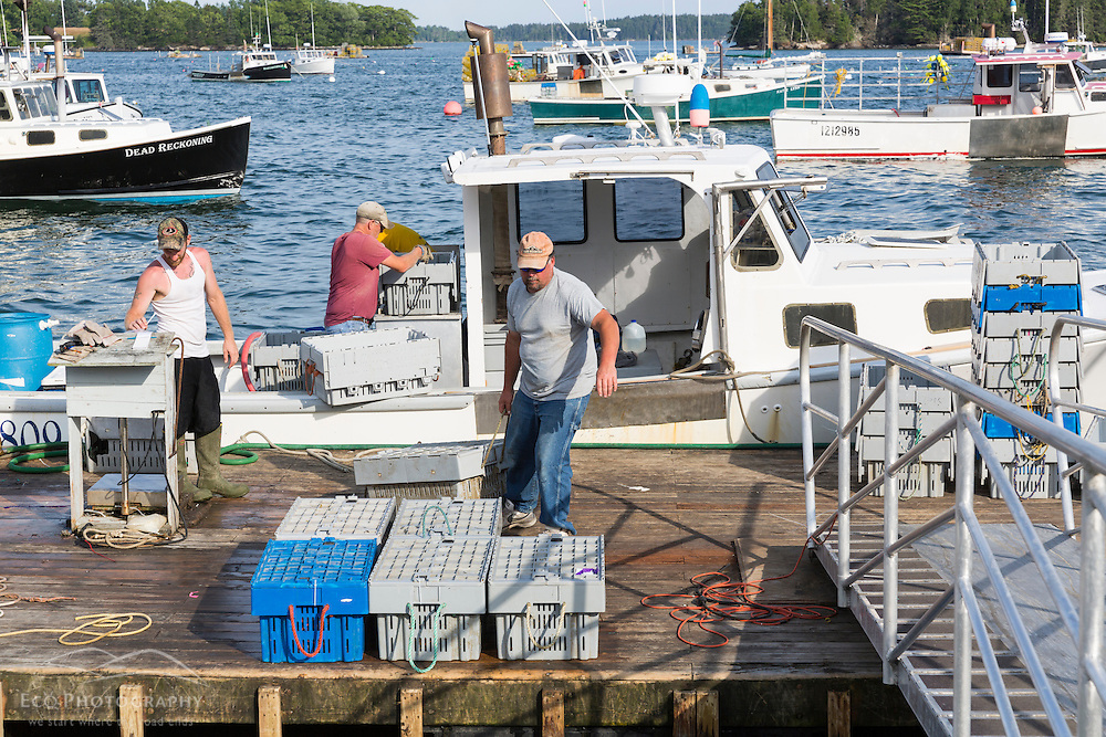 Co-op president Jim Wotton (right) helps unload lobster at the Friendship Lobster Co-op in Friendship, Maine.