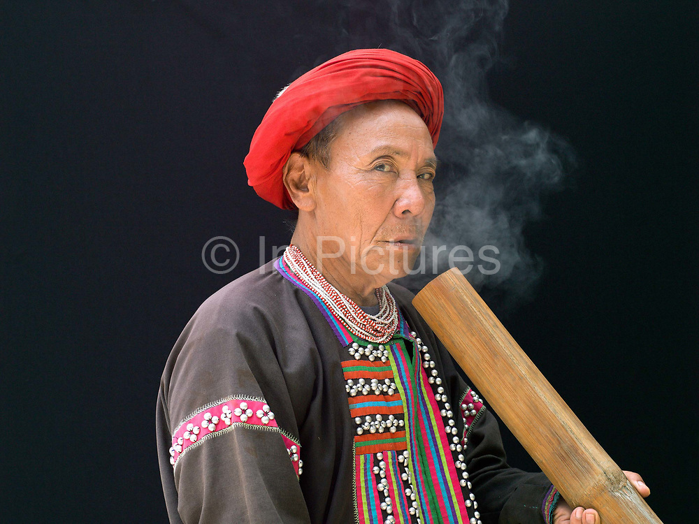 Ja Sat 67 an ethnic Lahu man from Laos at Baan Tong Luang, Eco-Agricultural Hill Tribes Village on 7th June 2016 in Chiang Mai province, Thailand. The fabricated village is home to 8 different hill tribes who make a living from selling their handicrafts and having their photos taken by tourists
