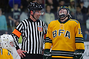 BFA's Meghan Connor (19) has a laugh with the referee during the Vermont state division I girls hockey championship game between the Essex Hornets and the BFA St. Albans Comets at Gutterson Field House on Monday night March 12, 2018 in Burlington. (BRIAN JENKINS/for the FREE PRESS)