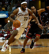 PHOTO BY DAVID RICHARD.LeBron James of the Cleveland Cavaliers drives past Miami's Derek Anderson April 1, 2006.