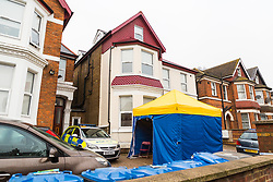 A police tent has been erected outside the House in Craven Park Road, Harlesden, West London, where two bombs were discovered by workers refurbishing a flat. Harlesden, London, November 22 2018.