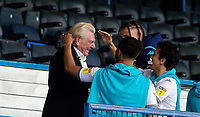 Leeds United player liaison officer Stix Lockwood is hugged by Tyler Roberts, Ian Poveda and Kalvin Phillips<br /> <br /> Photographer Alex Dodd/CameraSport<br /> <br /> The EFL Sky Bet Championship - Leeds United v Charlton Athletic - Wednesday July 22nd 2020 - Elland Road - Leeds <br /> <br /> World Copyright © 2020 CameraSport. All rights reserved. 43 Linden Ave. Countesthorpe. Leicester. England. LE8 5PG - Tel: +44 (0) 116 277 4147 - admin@camerasport.com - www.camerasport.com