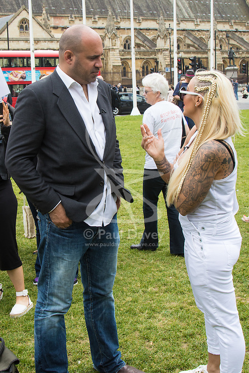 """Westminster, London, May 24th 2016. Animal rights protesters from """"Boycott Dogs4Us"""" protest outside Parliament against puppy farming and third party puppy selling as the Environment, Food and Rural Affairs Sub-Committee are investigating the sale of dogs as part of their animal welfare inquiry. PICTURED: TV Vet Marc Abraham and Jodie Marsh"""