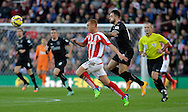 Two-goal Danny Ings of Burnley (right) competes with Steve Sidwell of fStoke City - Football - Barclays Premier League - Stoke City vs Burnley - Britannia Stadium Stoke - Season 2014/2015 - 22nd November 2015 - Photo Malcolm Couzens /Sportimage