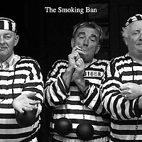 Kerry Vintners Association John o'Sullivan, left, Patrick o'Donoghue and Danny Leane are jail birds for the day for not enforcing the proposed smoking ban. The light heartted event took place in College Street, Killarney during the Fianna fail Ard Fheis and also included publicans John O'Sullivan, danny Leane and Patrick o'Donoghue.<br /> Picture by Don macMonagle