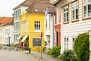 An outdoor cafe on a colourful street in the Nordness area of Bergen, Vestlandet, Norway
