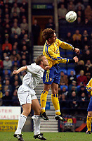 Photo. Jed Wee.<br /> Bolton Wanderers v Southampton, FA Barclaycard Premiership, Reebok Stadium, Bolton. 08/11/03.<br /> Southampton's Claus Lundekvam (R) beats Bolton's Kevin Davies to the ball.
