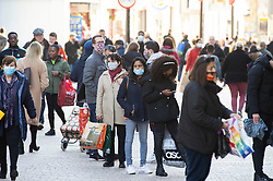 © Licensed to London News Pictures. 04/11/2020.  <br /> Bromley, UK. People queuing outside Smiths. Last minute lockdown panic buying shoppers flock to Bromley High Street in South London this afternoon to get food essentials and Christmas gifts. Photo credit:Grant Falvey/LNP