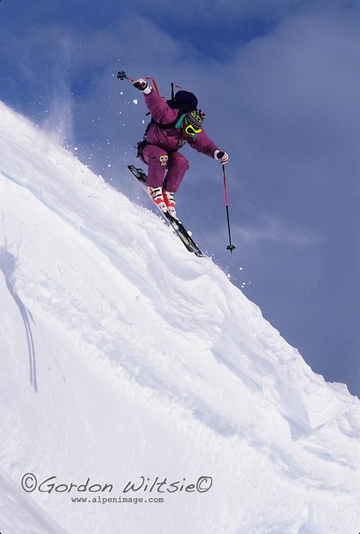 ANTARCTICA, Skier Kevin Andrews (MR) in powder snow, Detroit Plateau, Danco Coast, Ant. Peninsula.
