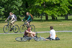 ©Licensed to London News Pictures 12/05/2020<br /> Greenwich, UK. Friends sitting on the grass chatting. People come out of Coronavirus lockdown to enjoy the warm weather by relaxing in Greenwich park, Greenwich, London this afternoon. Photo credit: Grant Falvey/LNP