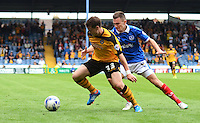 Newport County's Mark Byrne under pressure from Portsmouth's Jed Wallace<br /> <br /> Photographer Kevin Barnes/CameraSport<br /> <br /> Football - The Football League Sky Bet League Two - Portsmouth v Newport County AFC - Saturday 30th August 2014 - Fratton Park - Portsmouth<br /> <br /> © CameraSport - 43 Linden Ave. Countesthorpe. Leicester. England. LE8 5PG - Tel: +44 (0) 116 277 4147 - admin@camerasport.com - www.camerasport.com